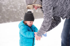 Young father with his son, playing in the snow. Young father having fun with his son, playing in the snow. Foggy white winter nature Stock Photos