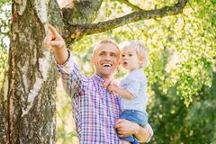 Young father with his son spending time in the park Stock Photos