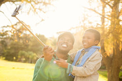Young father and his son taking selfies Stock Image