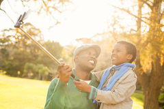 Young father and his son taking selfies Stock Photography