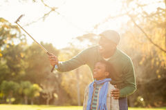 Young father and his son taking selfies Royalty Free Stock Photo