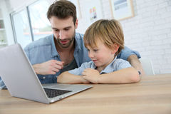 Young father and his son using a laptop Royalty Free Stock Photo