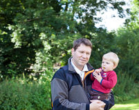 Young father and his toddler boy in summer forest Stock Image