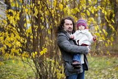 Young father and his toddler girl in autumn Royalty Free Stock Images
