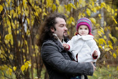 Young father and his toddler girl in autumn Stock Photo