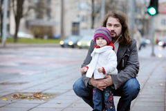 Young father and his toddler girl at autumn Stock Image