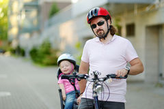 Young father and his toddler girl riding a bicycle Royalty Free Stock Image