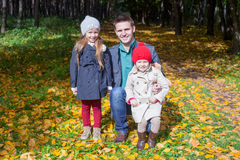 Young father and his two adorable little daughters Stock Photos