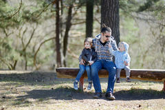 Young father and his two daughters Royalty Free Stock Images