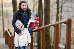 Young father and his two little daughters Royalty Free Stock Photography