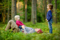 Young father and his two little daughters royalty free stock photo