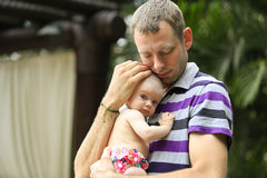 Young Father is holding beautiful little baby girl. Royalty Free Stock Photos