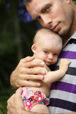 Young Father is holding beautiful little baby girl. Royalty Free Stock Images