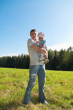 Young father holding a child Stock Photos