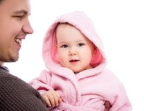 Young father holding cute baby girl in pink bathrobe after bath isolated on white royalty free stock images