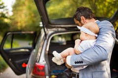 Young father with his little baby girl standing by the car. Stock Photography