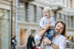 Young father holding his little girl Stock Images