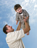 Young father holding his little son Stock Photography
