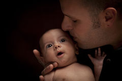 Young Father Holding His Mixed Race Newborn Baby Royalty Free Stock Photo