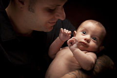 Young Father Holding His Mixed Race Newborn Baby Stock Images