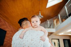 Young father holding his newborn baby son. Close up of young father holding his newborn baby son Stock Photography