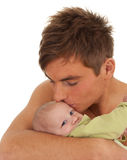 Young father holding lovely three months old son Stock Photo