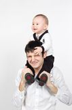 Young father holding smiling little son on his sho Stock Photos
