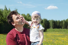 Young father holds happy little daughter Stock Photography
