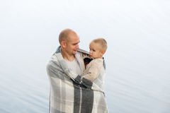 The young father holds the little son on hands. Portrait close up Royalty Free Stock Image