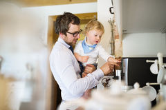 Young father at home with his son. Royalty Free Stock Photos
