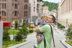 Young father hugging son on the street Royalty Free Stock Image