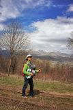 Young father with infant baby in sling carrier hiking in Armenia Stock Images