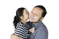 Young father kissed with his daughter. Image of young father kissed with his daughter while playing with crayons, isolated on white background Royalty Free Stock Photo