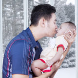 Young father kissing his little baby Stock Images