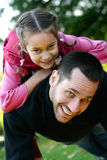 Young father lifting his daughter up stock photo