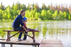 Young father and little adorable girl fishing on Royalty Free Stock Images