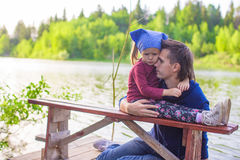 Young father and little adorable girl fishing Stock Photos