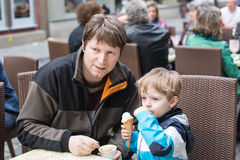 Young father and little boy eating ice cream Stock Images