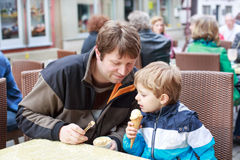 Young father and little boy eating ice cream Royalty Free Stock Images