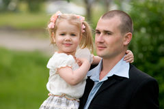 Young father and little daughter Stock Images