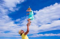Young father and little daughter have fun on the Royalty Free Stock Photos
