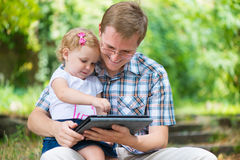 Young father and little daughter reading Stock Photo