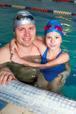 Young father with little daughter swimming in pool Stock Images