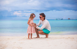 Young father and little daughter during tropical Stock Photos