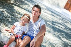 Young father with little daughters have a rest on Stock Images