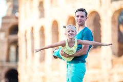 Young father and little girl background Colosseum, Rome, Italy royalty free stock photo