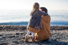 Young father and little girl at the beach on a Royalty Free Stock Photos