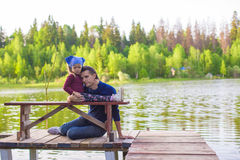 Young father and little girl fishing outdoor Royalty Free Stock Photography
