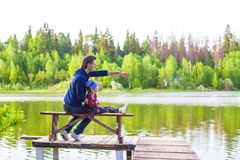 Young father and little girl fishing outdoor Royalty Free Stock Images