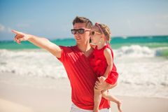 Young father with little girl on tropical beach Stock Photos